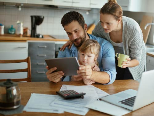 family at table looking at tablet